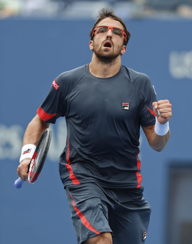 Janko Tipsarevic of Serbia reacts after scoring a point against Spain's David Ferrer in the quarterfinals during the 2012 US Open tennis tournament, Thursday, Sept. 6, 2012, in New York. (AP Photo/Julio Cortez)