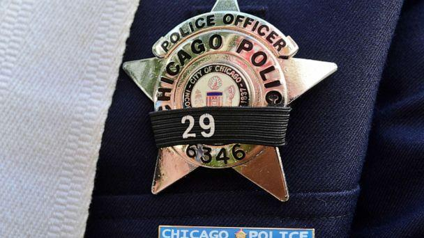 PHOTO: A police officer's badge is covered in a black band at a prayer vigil in remembrance of Police Officer Ella French and her wounded partner on Aug. 11, 2021, in Chicago. (Anadolu Agency via Getty Images, FILE)