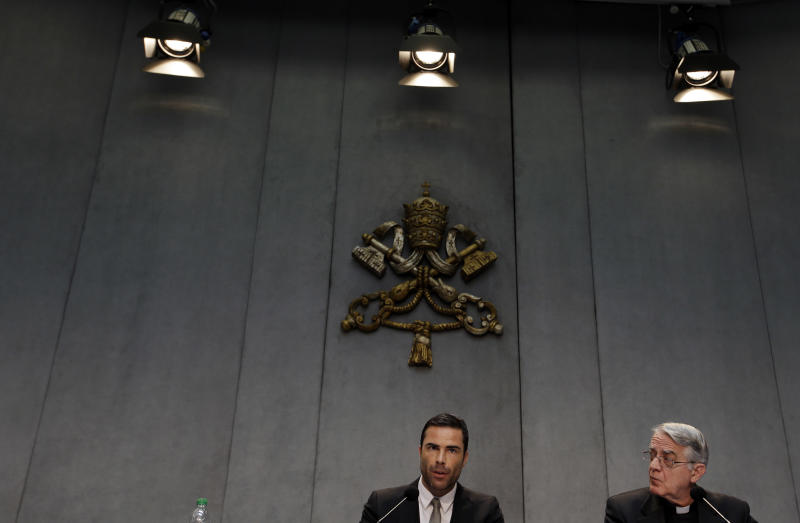 Rene Brulhart, director of the  Financial Information Authority, an institution established by Pope Benedict XVI in 2010 to monitor the monetary and commercial activities of Vatican agencies, and Vatican spokesman Federico Lombardi, meet the press at the Vatican, Wednesday, May 22, 2013. The Vatican took another step Wednesday in trying to show greater financial transparency by publishing a first annual report from its financial watchdog agency and announcing new regulations to fight money laundering and terror financing that are expected in the coming weeks and months. (AP Photo/Gregorio Borgia)