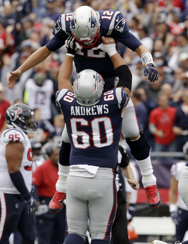 <p>New England Patriots quarterback Tom Brady (12) gets a lift from center David Andrews after throwing a touchdown pass to Rob Gronkowski during the first half of an NFL football game against the Houston Texans, Sunday, Sept. 9, 2018, in Foxborough, Mass. (AP Photo/Charles Krupa) </p>