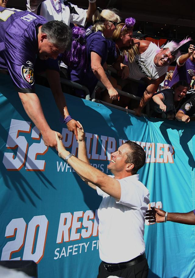Baltimore Ravens head coach John Harbaugh is congratulated by fans after defeating the Miami Dolphins 26-23 at an NFL football game, Sunday, Oct. 6, 2013, in Miami Gardens, Fla. (AP Photo/J Pat Carter)