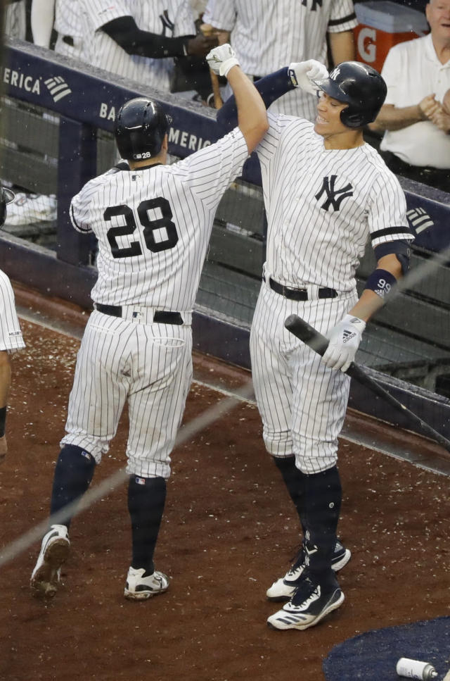 New York Yankees' Aaron Judge, right, celebrates with Austin Romine (28) after Romine hit a two-run home run during the seventh inning of a baseball game against the Arizona Diamondbacks Wednesday, July 31, 2019, in New York. (AP Photo/Frank Franklin II)