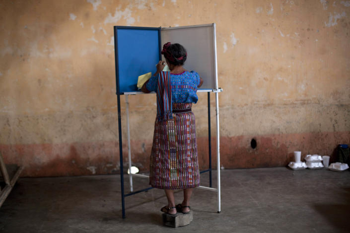 A woman casts her vote during the country's general elections in San Lucas Toliman, Guatemala, Sunday, Sept. 11, 2011. Polls have indicated that Otto Perez Molina of the Patriotic Party, a former army general, is the leading candidate in Sunday's election. (AP Photo/Rodrigo Abd)