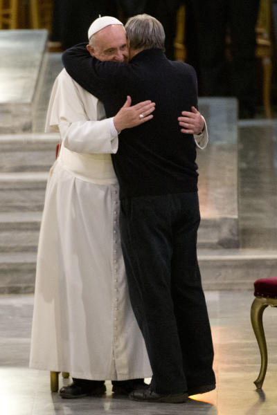 Pope Francis embraces Don Luigi Ciotti as he arrives for a meeting with relatives of innocent mafia victims, in Rome's St. Gregorio VII church, just outside the Vatican, Friday, March 21, 2014. (AP Photo/Andrew Medichini)