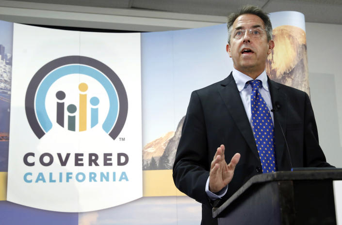 FILE - In this Nov. 13, 2013, file photo, Peter Lee, executive director of Covered California, the state's health insurance exchange, talks at a news conference in Sacramento, Calif. California has re-opened enrollment for its state health insurance exchange. People can now purchase health insurance plans from Covered California through the end of the year. Lee said Monday, April 12, 2021, the goal is to get more people to buy health insurance. (AP Photo/Rich Pedroncelli, File)