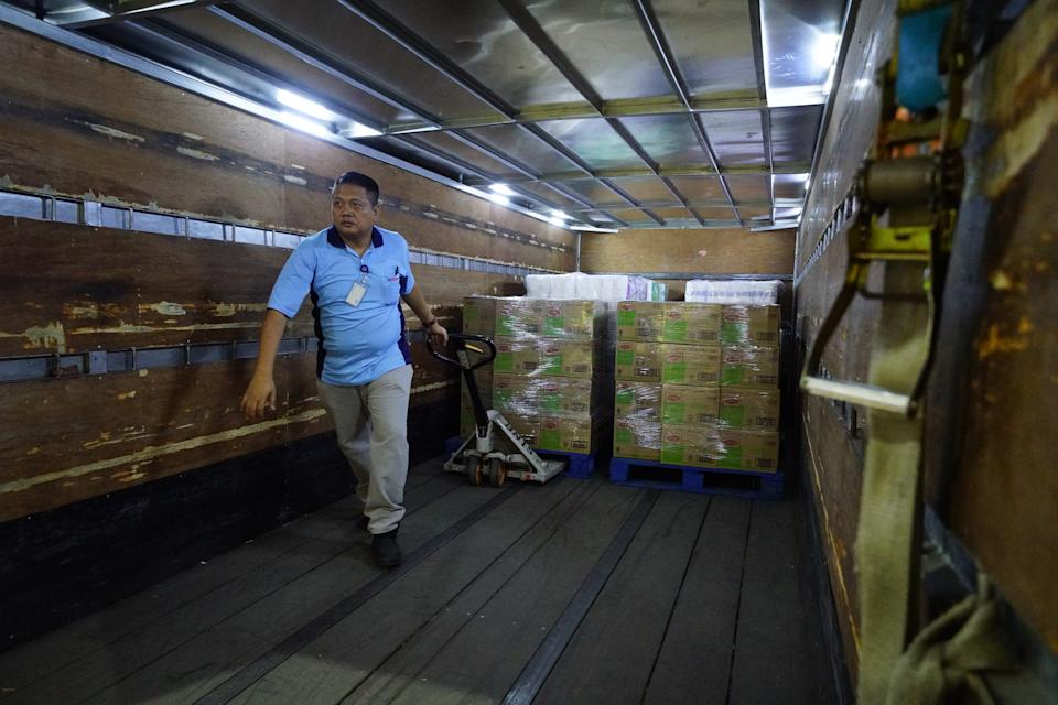 Instant noodles being loaded for delivery to a FairPrice supermarket. (PHOTO: NTUC FairPrice)