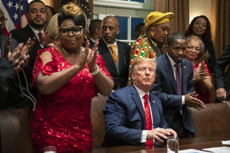 African American leaders applaud President Donald Trump as they end their meeting in the Cabinet Room of the White House, Thursday, Feb. 27, 2020, in Washington. (AP Photo/Manuel Balce Ceneta)