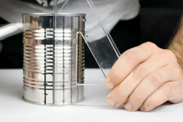 Recycling a cheap tin can into a DIY grater is the ultimate kitchen hack