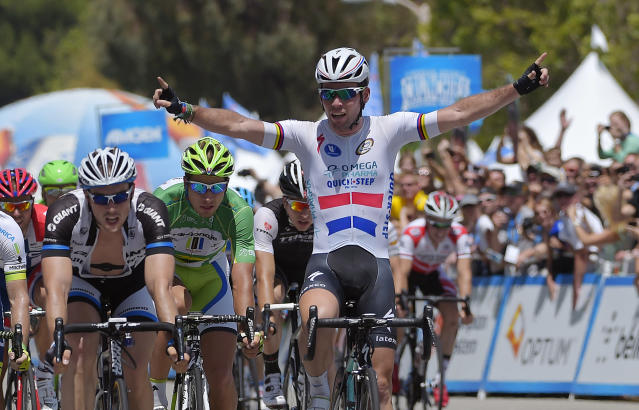 Mark Cavendish of Great Britain, gestures after winning the final stage of the Tour of California cycling race, Sunday, May 18, 2014, in Thousand Oaks, Calif. Finishing behind him are John Degenkolb, left, of Germany, and Peter Sagan, second from left, of Slovakia. Winning the overall race was Bradley Wiggins, of Great Britain. (AP Photo/Mark J. Terrill)
