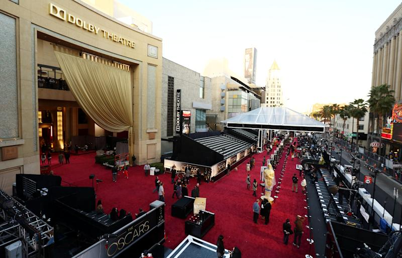 People prepare the red carpet at the Dolby Theatre for the 85th Academy Awards in Los Angeles, Saturday, Feb. 23, 2013. The Academy Awards are scheduled for Sunday, Feb. 24, 2013. (Photo by Matt Sayles/Invision/AP)