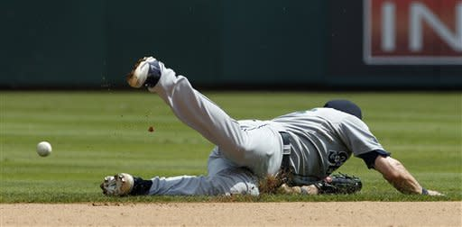 Seattle Mariners shortstop Brendan Ryan (26) is unable to reach an RBI-single to center off the bat of Texas Rangers' Michael Young in the seventh inning of a baseball game on Thursday, April 12, 2012, in Arlington, Texas. The Rangers won 5-3. (AP Photo/Tony Gutierrez)