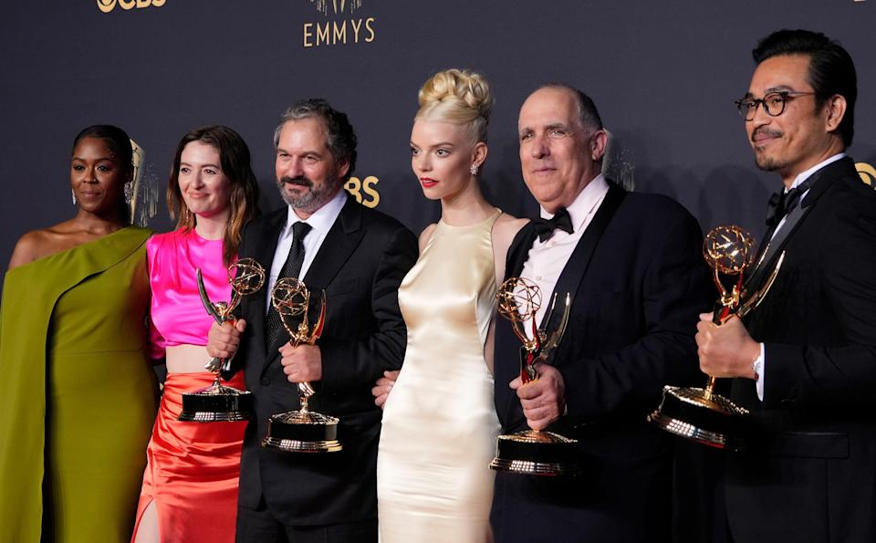 """Moses Ingram (far left), Marielle Heller, Scott Frank, Anya Taylor-Joy, William Horberg and Mick Aniceto pose at the Emmy Awards after """"The Queen's Gambit"""" won for best limited series."""