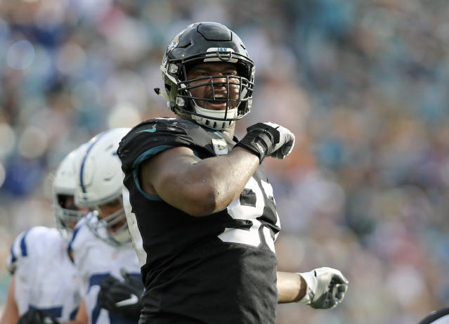 Jacksonville Jaguars defensive end Calais Campbell (93) reacts after sacking Indianapolis Colts quarterback Andrew Luck during the second half of an NFL football game, Sunday, Dec. 2, 2018, in Jacksonville, Fla. (AP Photo/Gary McCullough)