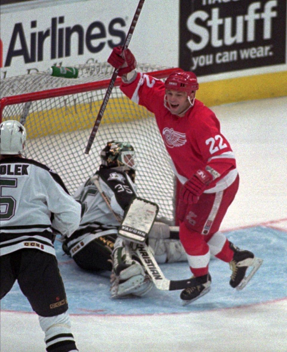 1994-95: The Red Wings finished 33-11-4 in a lockout-shortened season, winning the President's Trophy, but losing in the Stanley Cup Finals in four games to the New Jersey Devils. Pictured is Dino Ciccarelli.