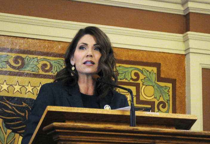 "FILE - In this Jan. 23, 2019, file photo, Gov. Kristi Noem gives her first budget address to lawmakers at the state Capitol in Pierre, S.D. Hospitalizations from COVID-19 have hit their highest points recently throughout the Midwest, where the growth in new cases has been the worst in the nation. ""In South Dakota, we didn't take a one size fits all approach and the results have been incredible,"" Gov. Kristi Noem told lawmakers in her state, which Johns Hopkins University says ranks second in the country for new cases per capita. (AP Photo/James Nord, File)"