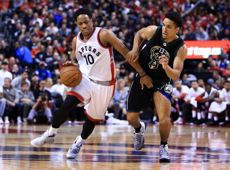 DeMar DeRozan (L) of the Toronto Raptors tries to get past Malcolm Brogdon of the Milwaukee Bucks in the second half of Game One of the Eastern Conference quarter-finals during the 2017 NBA Playoffs, in Toronto, on April 15