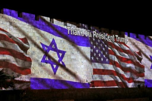 The Israeli and United States flags are projected on the walls of the ramparts of Jerusalem's Old City, to mark the opening of the new US embassy on May 14, 2018
