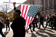 People wearing pro- Proud Boys clothing march down Pennsylvania Avenue with supporters of President Donald Trump, Saturday Nov. 14, 2020, in Washington. (AP Photo/Jacquelyn Martin)