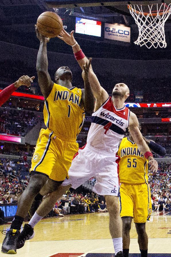 Indiana Pacers guard Lance Stephenson (1) shoots over Washington Wizards center Marcin Gortat (4) of Poland during the first half of Game 3 of an Eastern Conference semifinal NBA basketball playoff game in Washington, Friday, May 9, 2014. (AP Photo/Alex Brandon)