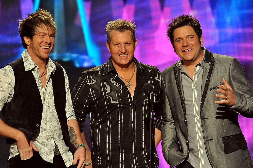 Jay DeMarcus, Gary LeVox, Joe Don Rooney of Rascal Flatts onstage at the 2009 American Music Awards at Nokia Theatre L.A. Live on November 22, 2009 in Los Angeles, California.
