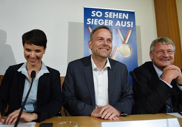 """Leader of """"Alternative for Germany"""" (AfD) Frauke Petry, top candidate for the AFD in Mecklenburg-Western Vorpommern Leif-Erik Holm and parliamentary group leader of the AFD Joerg Meuthen attend a press conference in Berlin, on September 5, 2016 (AFP Photo/Odd Andersen)"""
