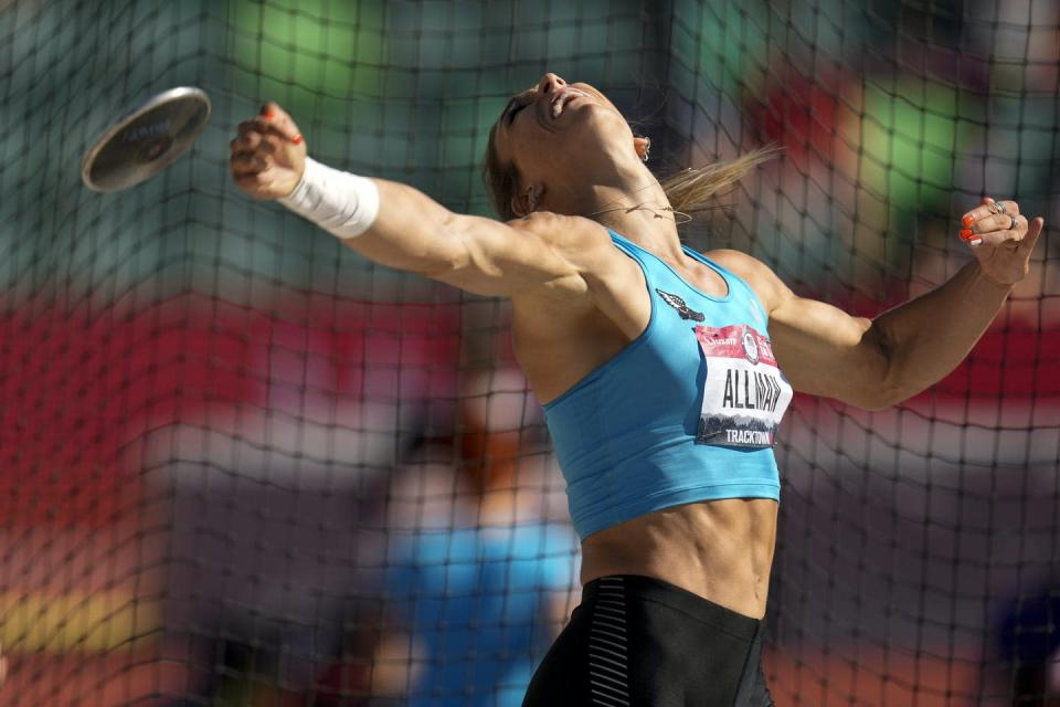 Women throwing a discus