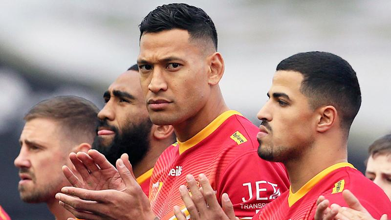 Pictured here, Israel Folau alongside Catalans teammates before a match.