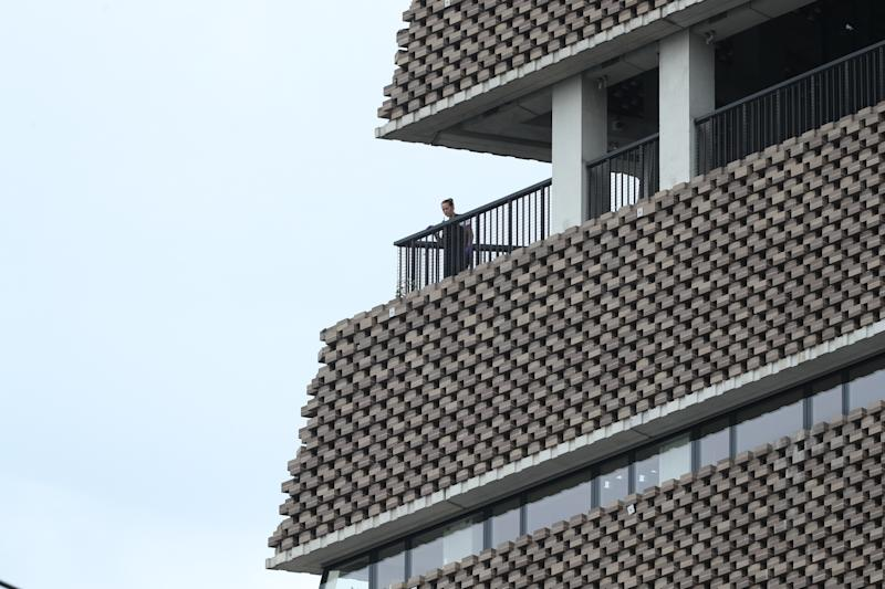 A police officer looks out from the viewing platform at the Tate Modern art gallery, following the arrest of a 17-year-old male on suspicion of attempted murder after a six-year-old boy was thrown from the tenth floor viewing platform.