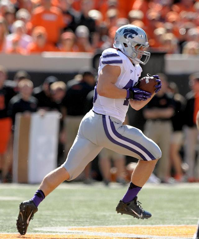 Kansas State's Glenn Gronkowski runs for a touchdown on a pass from Daniel Sams, during the first half of an NCAA college football game in Stillwater, Okla., Saturday, Oct. 5, 2013. (AP Photo/Brody Schmidt)