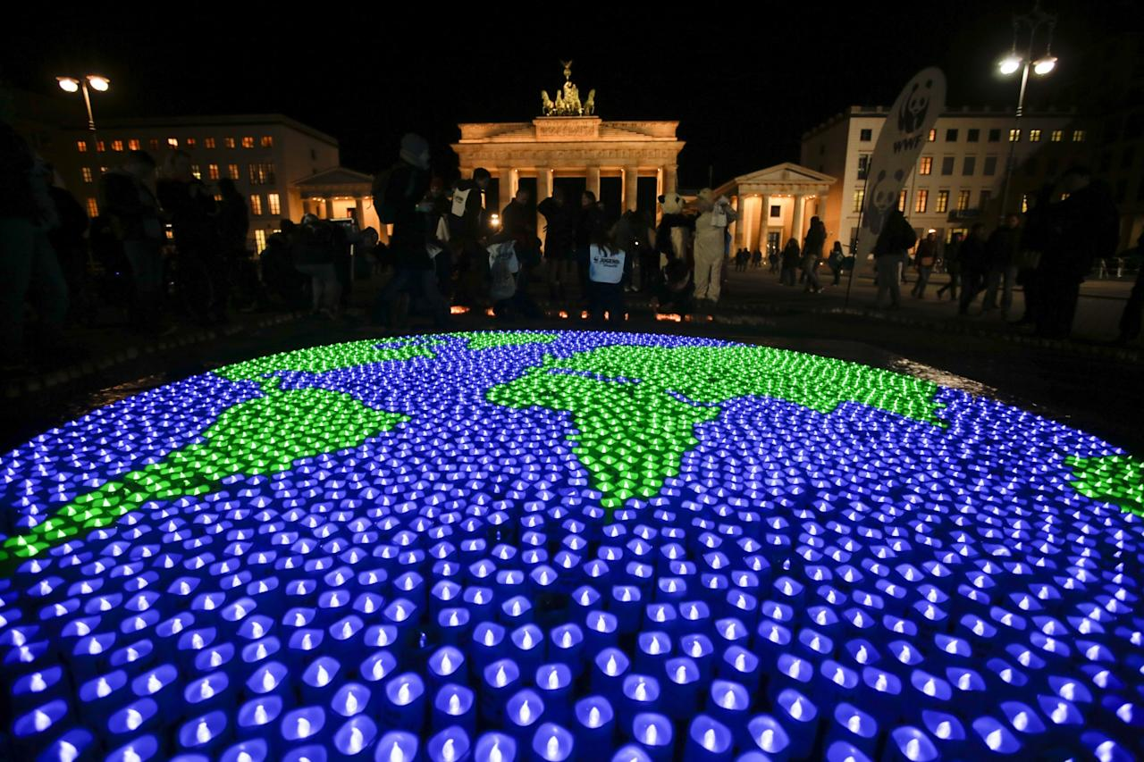 <p>A globe illuminated with led-lights by activists of the World Wide Fund For Nature (WWF) in front of the Brandenburg Gate to mark Earth Hour, in Berlin, Saturday, March 25, 2017. (AP Photo/Markus Schreiber) </p>