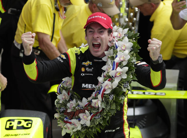 FILE - In this Sunday, May 26, 2019, file photo, Simon Pagenaud, of France, celebrates after winning the Indianapolis 500 IndyCar auto race at Indianapolis Motor Speedway. The IndyCar season opener is Sunday, March 15, 2020, in St. Petersburg, Fla. (AP Photo/Michael Conroy, File)