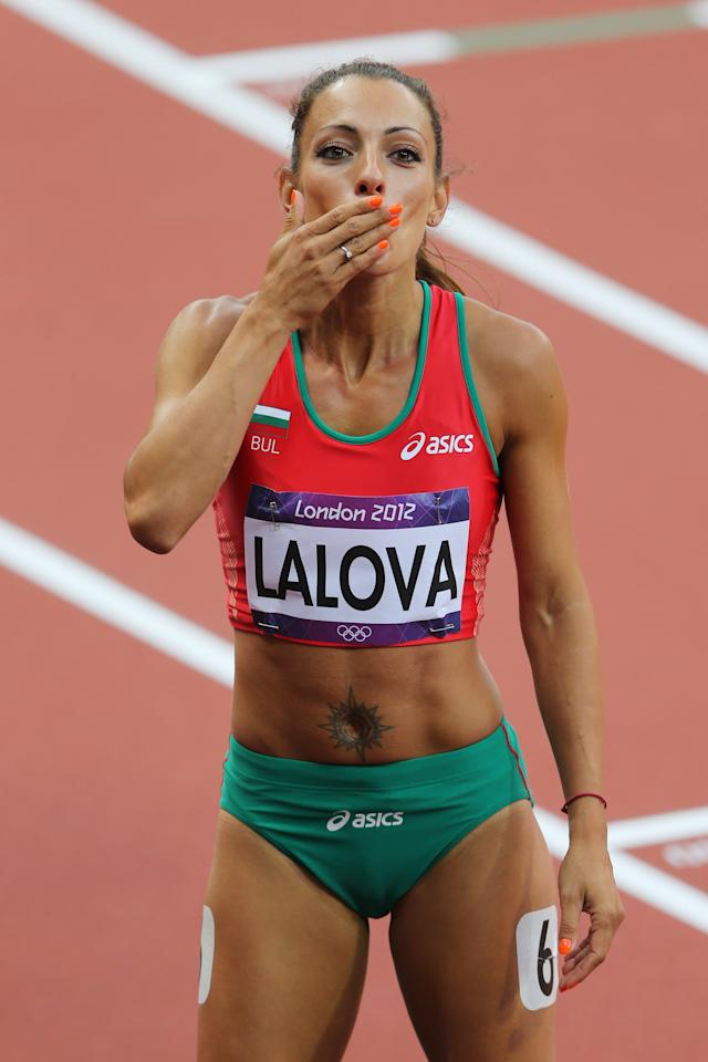 LONDON, ENGLAND - AUGUST 03:  Ivet Lalova of Bulgaria blows a kiss after competing in the Women's 100m Round 1 Heats on Day 7 of the London 2012 Olympic Games at Olympic Stadium on August 3, 2012 in London, England.  (Photo by Streeter Lecka/Getty Images)