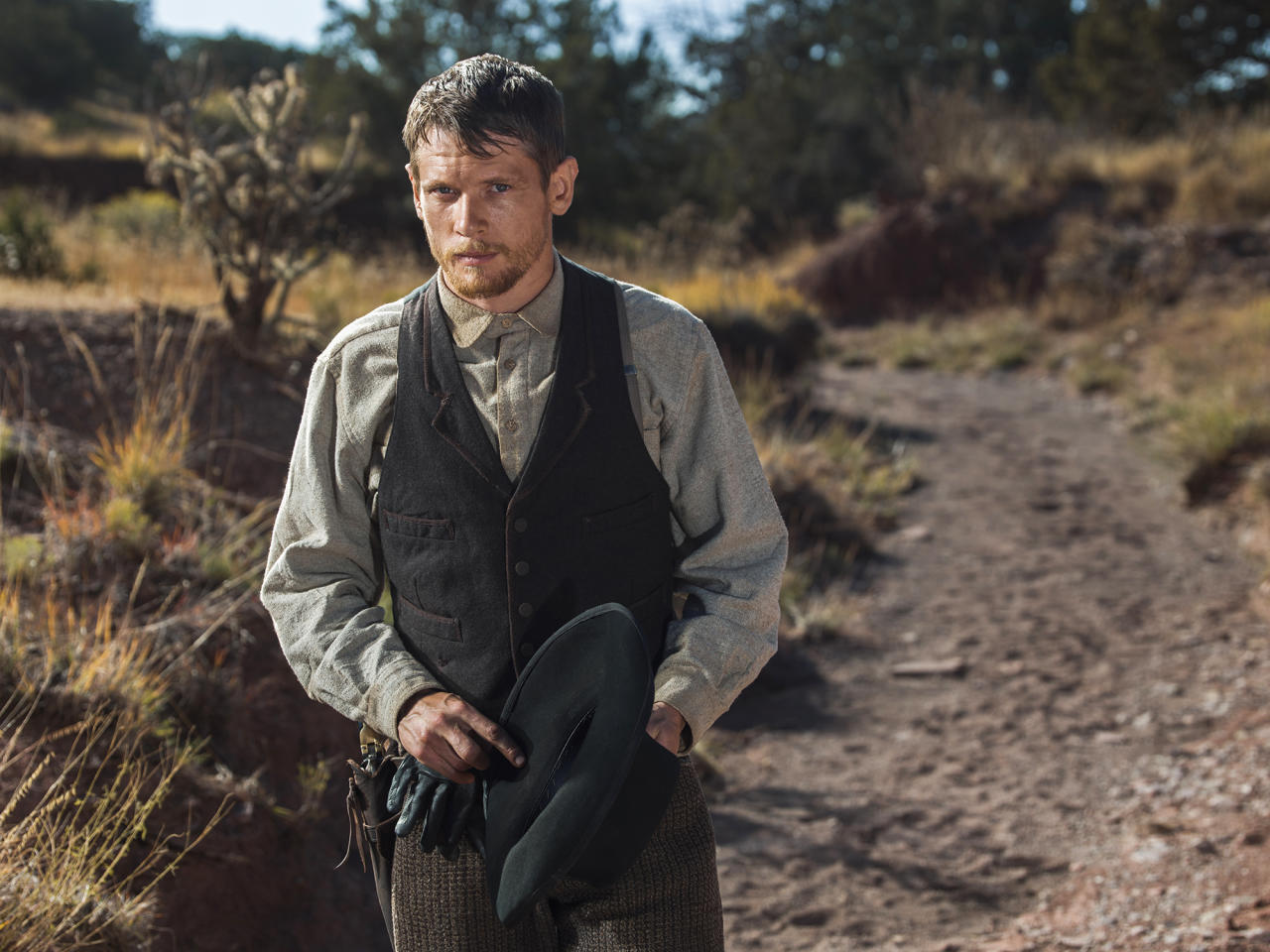 <p>That man is Roy Goode, who's good with a gun and Alice's wild horses. Once presumed dead, he's returned now to steal all the spoils from his former gang's latest train robbery — hence his injuries.<br />(Photo: James Minchin/Netflix) </p>