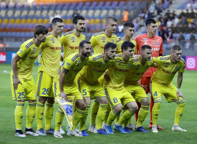Bate's team players pose for a photo prior to the Champions League second qualifying round, 1st leg soccer match between Bate and Rosenborg at the Borisov-Arena in Borisov, Belarus, Wednesday, July 24, 2019. (AP Photo/Sergei Grits)