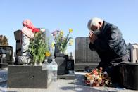 Bereaved local residents laid flowers at graves