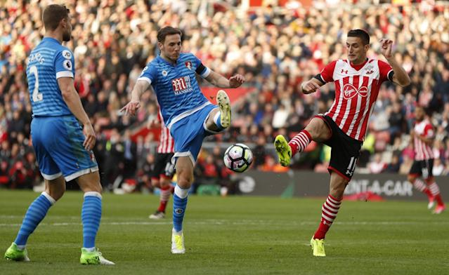 <p>Southampton's Dusan Tadic in action with Bournemouth's Dan Gosling </p>