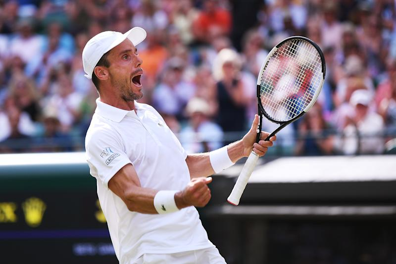 LONDON, ENGLAND - JULY 10: Roberto Bautista Agut of Spain celebrates match point in his Men's Quarter Final match against Guido Pella of Argentina during Day Nine of The Championships - Wimbledon 2019 at All England Lawn Tennis and Croquet Club on July 10, 2019 in London, England. (Photo by Laurence Griffiths/Getty Images)