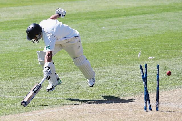 DUNEDIN, NEW ZEALAND - DECEMBER 03: Ross Taylor of New Zealand survives a run out during day one of the first test match between New Zealand and the West Indies at University Oval on December 3, 2013 in Dunedin, New Zealand. (Photo by Hannah Johnston/Getty Images)