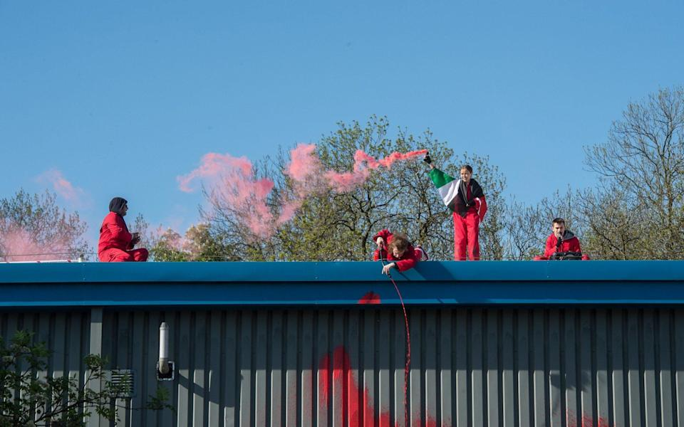 Paint is squirted on the building as activists from Palestine Action close down the Elbit systems drone factory, by climbing onto it's roof in protest at the company's links to the Israeli military - Guy Smallman/Getty Images Europe