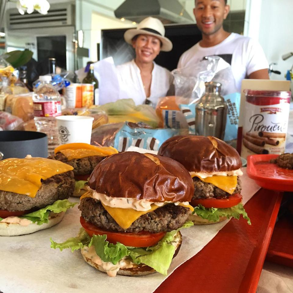 """To make your run-of-the-mill burger buns that much better, Teigen recommends cutting the bun in half, slathering it with butter, and then <a rel=""""nofollow"""" href=""""https://www.today.com/food/want-better-burger-bun-chrissy-teigen-shared-genius-hack-t116056"""">sprinkling unsweetened coconut flakes</a> on the top. Then, pop those babies into the oven and Teigen swears they'll come out toasted golden with a hint of tropical sweetness."""