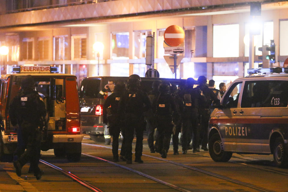 Police officers walk between emergency vehicles at the scene after gunshots were heard, in Vienna, Monday, Nov. 2, 2020. Austrian police say several people have been injured and officers are out in force following gunfire in the capital Vienna. Initial reports that a synagogue was the target of an attack couldn't immediately be confirmed. Austrian news agency APA quoted the country's Interior Ministry saying one attacker has been killed and another could be on the run.(Photo/Ronald Zak)