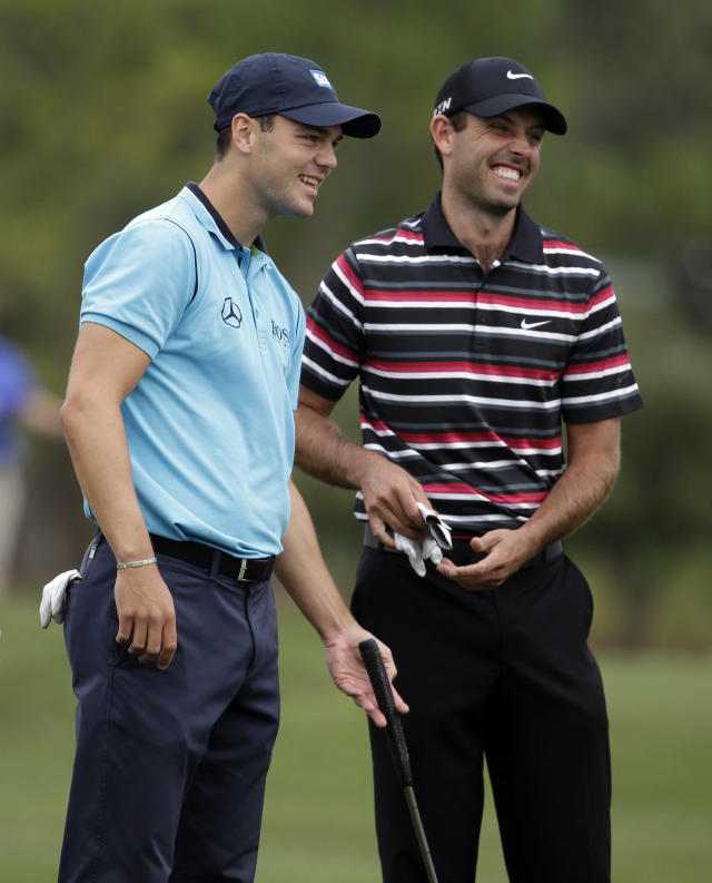 Martin Kaymer of Germany, left, and Charl Schwartzel of South Africa, talk while waiting to hit on the third fairway during the first round of the Honda Classic golf tournament, Thursday, Feb. 27, 2014, in Palm Beach Gardens, Fla. (AP Photo/Lynne Sladky)