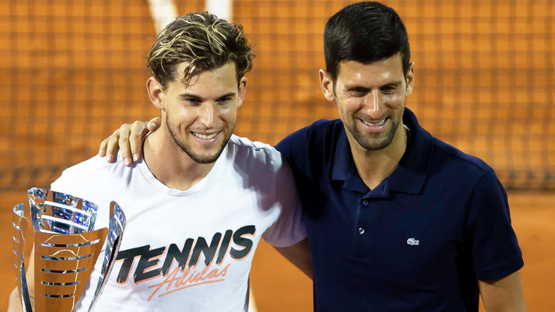 Dominic Thiem (pictured left) and Novak Djokovic (pictured right) embracing and posing for photos.