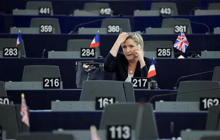 Marine Le Pen, French National Front  political party leader and Member of the European Parliament takes part in a voting session at the European Parliament in Strasbourg