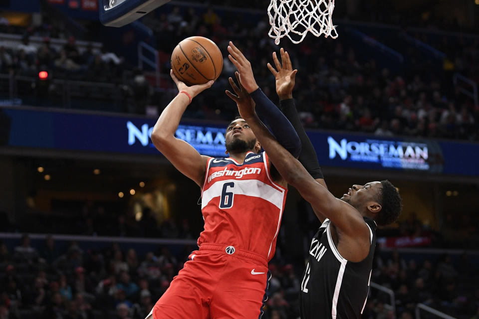 Washington Wizards forward Troy Brown Jr. (6) goes to the basket against Brooklyn Nets guard Caris LeVert (22) during the first half of an NBA basketball game, Saturday, Feb. 1, 2020, in Washington. (AP Photo/Nick Wass)