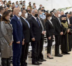 Israeli Prime Minister Benjamin Netanyahu, center, attends at a memorial ceremony for fallen soldiers at the Yad LeBanim House on the eve of Memorial Day, in Jerusalem, Tuesday, April 13, 2021. (Debbie Hill/Pool Photo via AP)