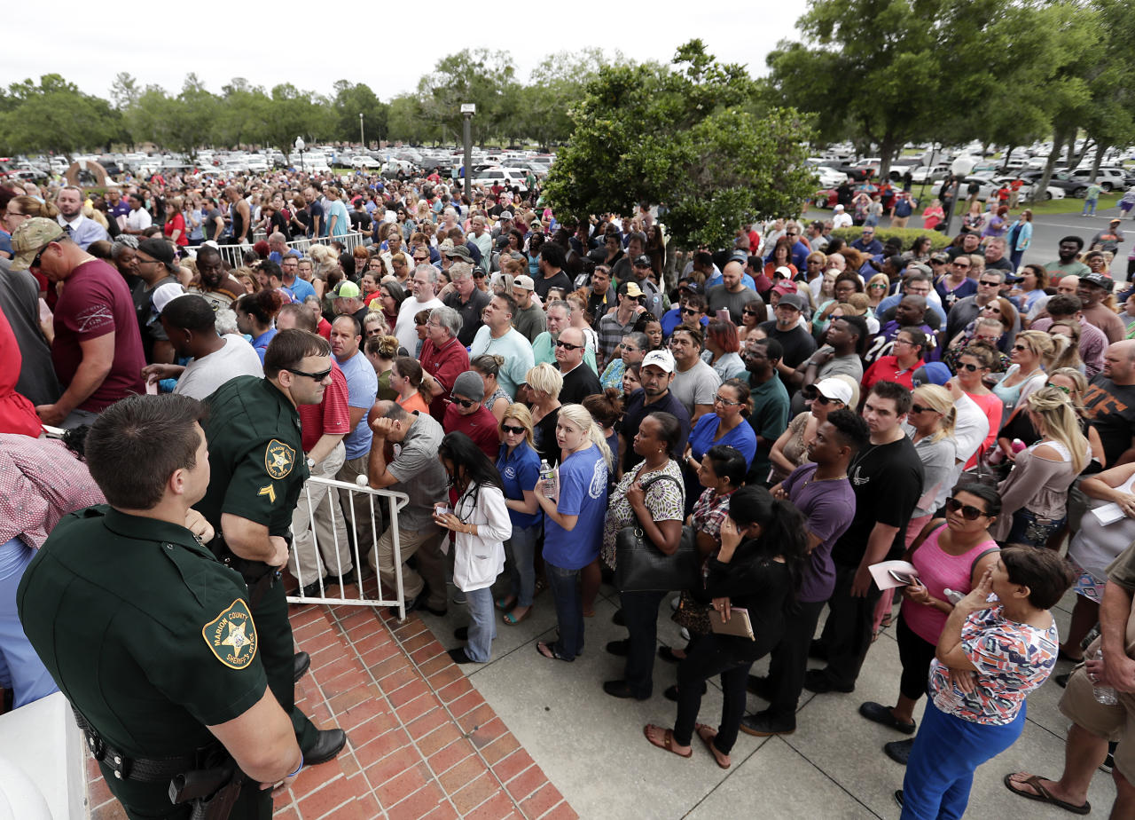 <p>Parents and relatives gather to pick up students at the First Baptist Church of Ocala after a shooting incident at nearby Forest High School, Friday, April 20, 2018, in Ocala, Fla. (Photo: John Raoux/AP) </p>