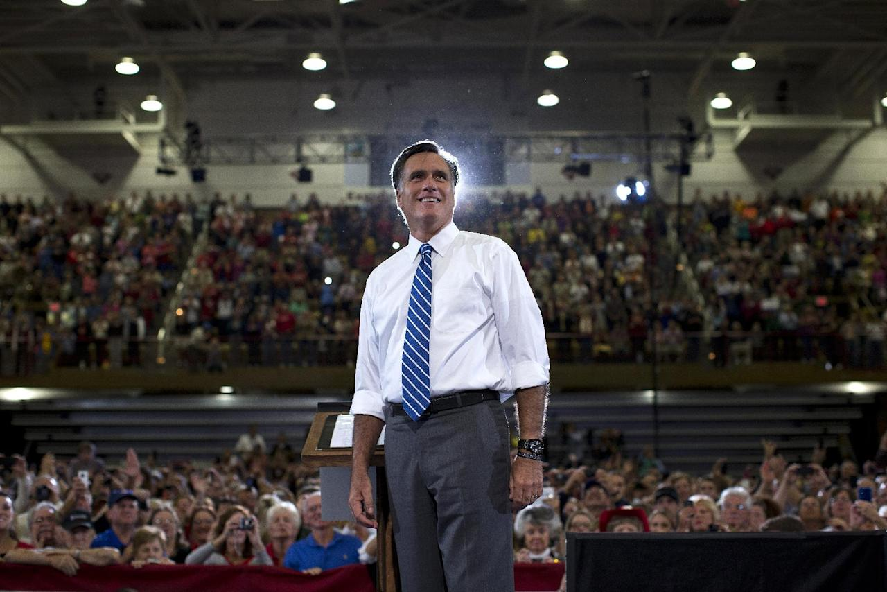 Republican presidential candidate, former Massachusetts Gov. Mitt Romney looks at the crowd after arriving to a campaign rally at the U.S. Cellular Center on Thursday, Oct. 11, 2012 in Asheville, N.C. (AP Photo/ Evan Vucci)