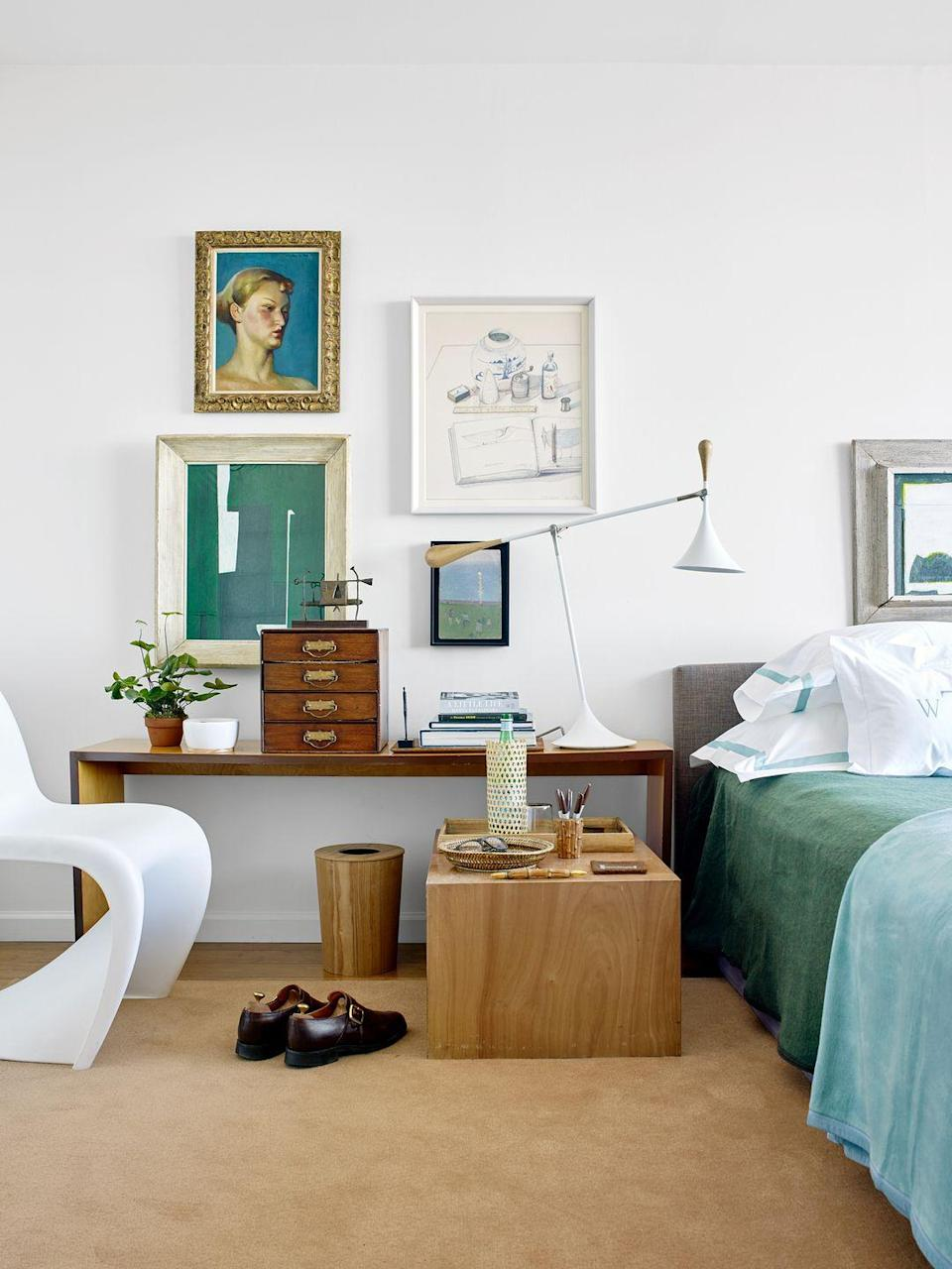 <p>If you do a lot of work from home, consider repurposing your console table into a desk or vanity table. In this bedroom, the side table provides room for extra office supplies as well as bedroom essentials and adjustable lamp is perfect for both studying at the table and reading in bed. </p>