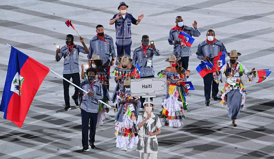 <p>Haiti's flag bearer Darrelle Valsaint Jr leads the delegation during the opening ceremony of the Tokyo 2020 Olympic Games, at the Olympic Stadium, in Tokyo, on July 23, 2021. (Photo by Martin BUREAU / AFP) (Photo by MARTIN BUREAU/AFP via Getty Images)</p>
